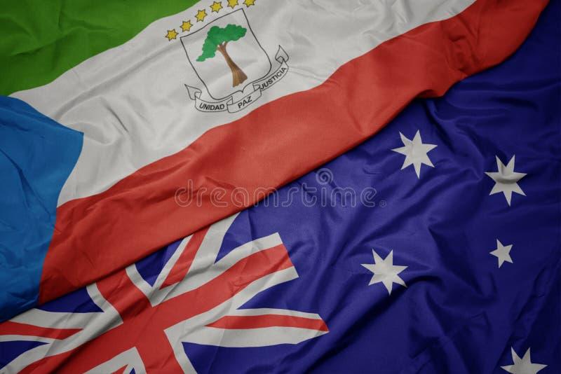 drapeau coloré de ondulation de l'australie et drapeau national de Guinée équatoriale photos libres de droits