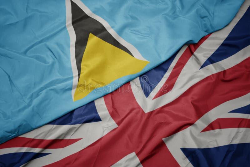 drapeau coloré de ondulation de la Grande-Bretagne et drapeau national du St Lucia photos stock