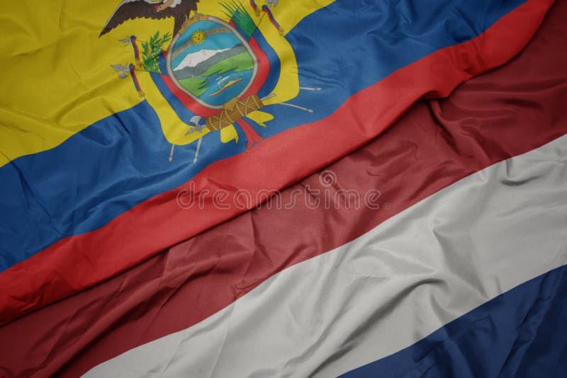 drapeau coloré des pays-bas et drapeau national de l' équateur images stock