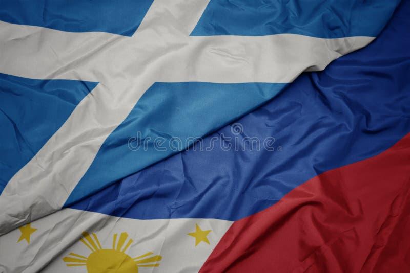drapeau coloré des philippines et drapeau national de l' écosse image stock