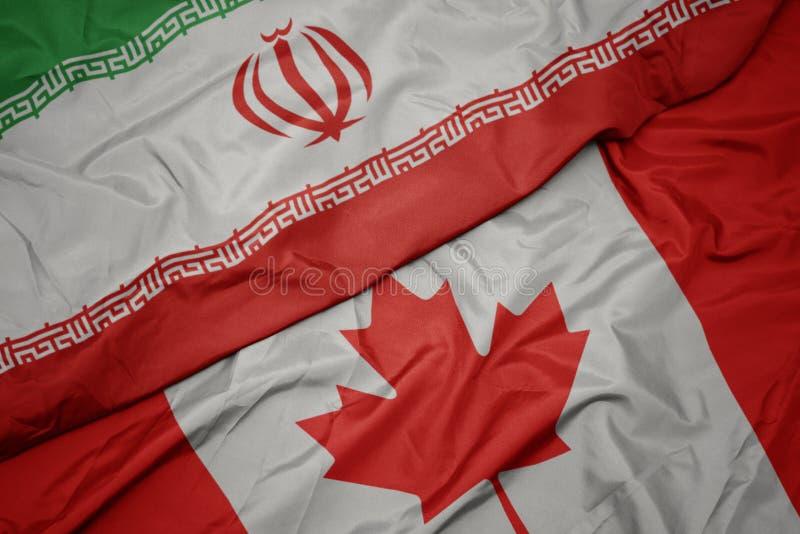 drapeau coloré du canada et drapeau national de l' iran photos libres de droits