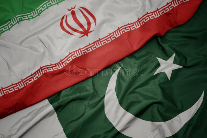 drapeau coloré du pakistan et drapeau national de l' iran photos stock