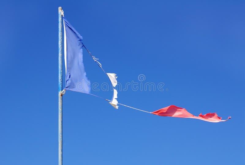 Drapeau déchiré français photographie stock libre de droits