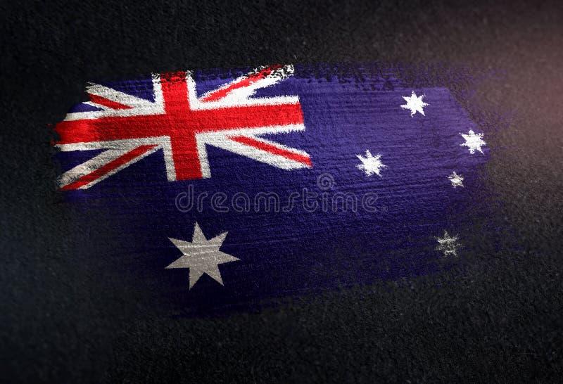 Drapeau d'Australie fait de peinture métallique de brosse sur le mur foncé grunge photo stock