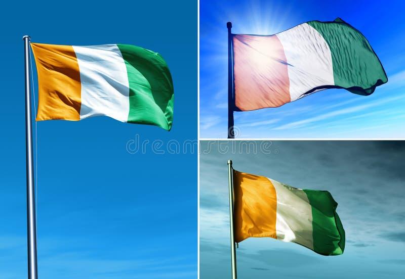 Drapeau d'Ivoire de Cote ondulant sur le vent images libres de droits