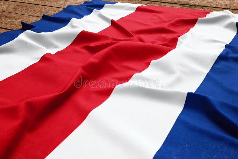 Drapeau de Costa Rica sur un fond en bois de bureau Vue sup?rieure de drapeau en soie de Costa Rican images stock