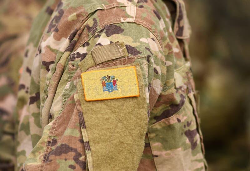 Drapeau de l'État du New Jersey sur l'uniforme militaire États-Unis États-Unis, armée, soldats Collage photographie stock