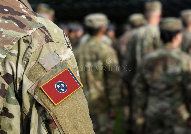 Drapeau de l'État du Tennessee sur l'uniforme militaire États-Unis États-Unis, armée, soldats Collage images libres de droits