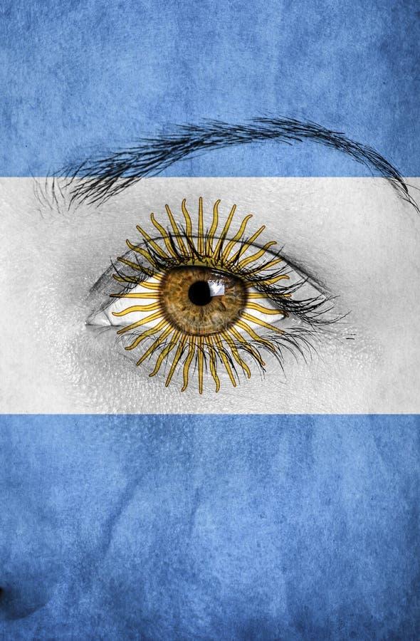 Drapeau de l'Argentine peint au-dessus du visage photo libre de droits