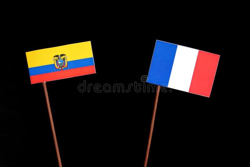 Drapeau de l'Equateur avec le drapeau français d'isolement sur le noir photo libre de droits