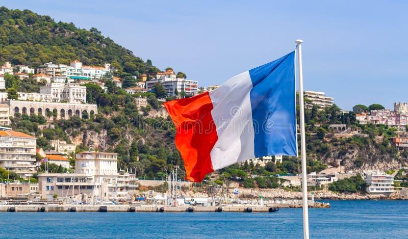 Drapeau de la France ondulant sur le vent images libres de droits