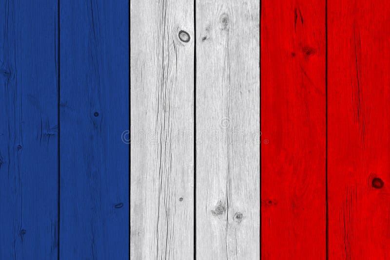 Drapeau de la France peint sur la vieille planche en bois images stock