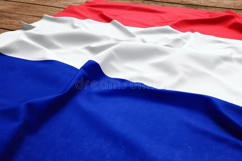 Drapeau de la France sur un fond en bois de bureau Vue sup?rieure de drapeau fran?ais en soie photos libres de droits
