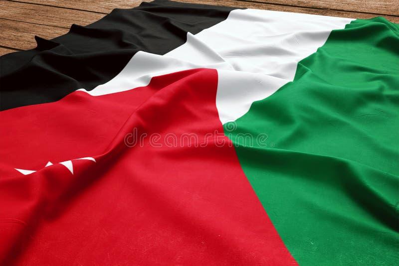 Drapeau de la Jordanie sur un fond en bois de bureau Vue sup?rieure de drapeau jordanien en soie photos stock