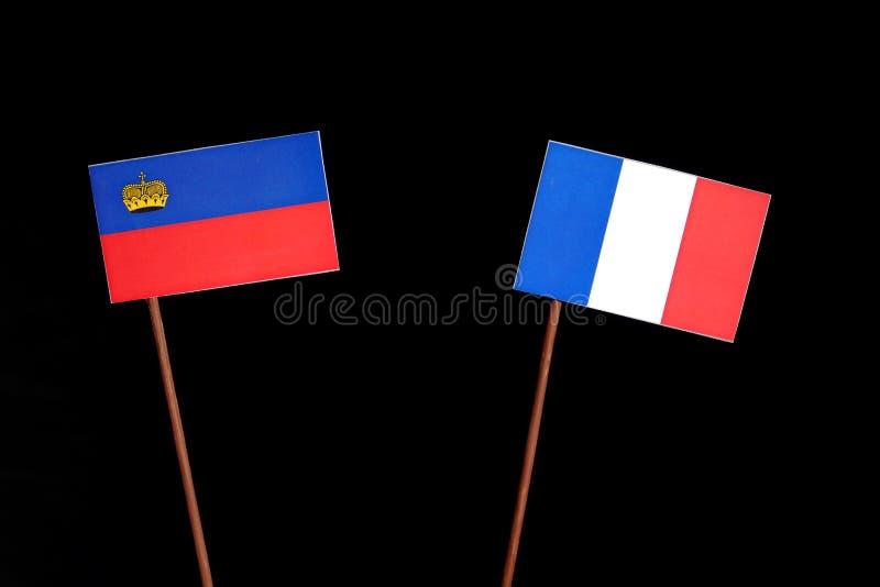 Drapeau de la Liechtenstein avec le drapeau français d'isolement sur le noir image stock