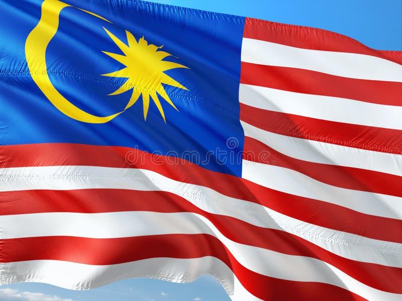 Drapeau de la Malaisie ondulant dans le vent contre le ciel bleu profond Tissu de haute qualit? image libre de droits