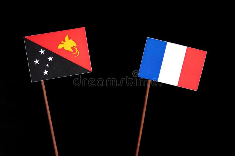 Drapeau de la Papouasie-Nouvelle-Guinée avec le drapeau français sur le noir photo stock