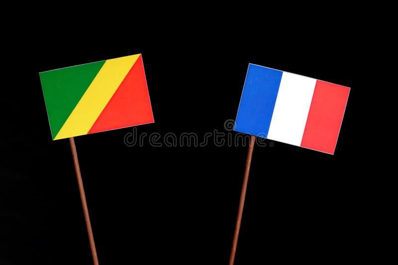 Drapeau de la République du Congo avec le drapeau français sur le noir images libres de droits