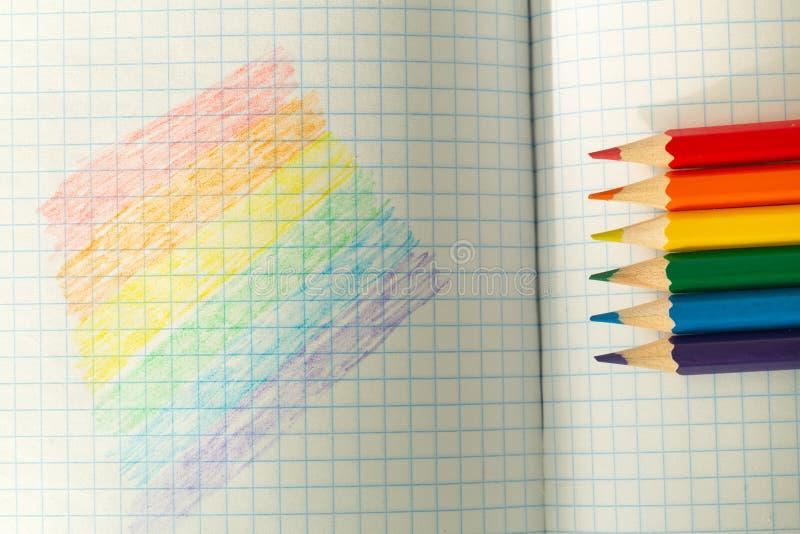 Drapeau de LGBT dessin? dans un carnet/?ducation d'?cole sur la tol?rance photos libres de droits