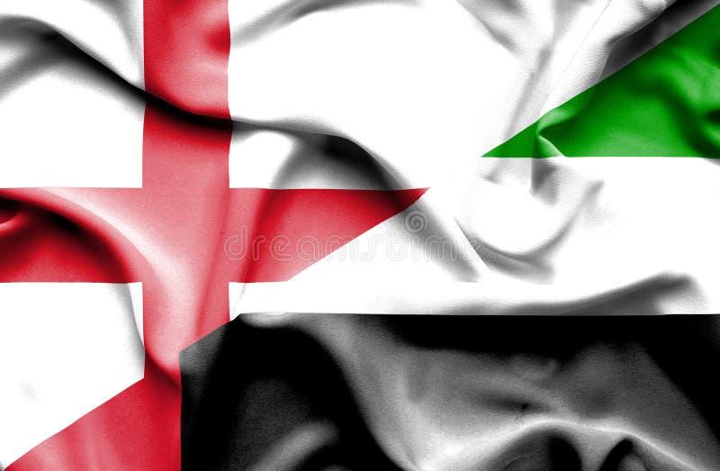 Drapeau de ondulation des Emirats Arabes Unis et de l'Angleterre image libre de droits