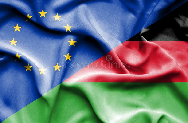 Drapeau de ondulation du Malawi et de l'UE photo stock