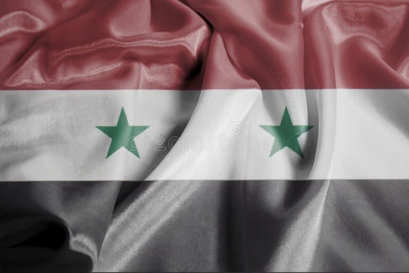 Drapeau de ondulation ondulé de la Syrie images stock