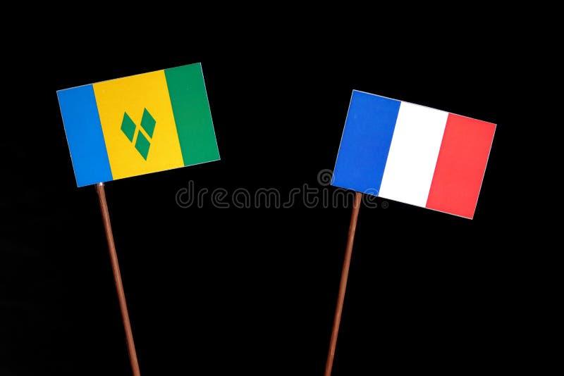 Drapeau de Saint Vincent et de grenadines avec le drapeau français sur le noir photographie stock libre de droits