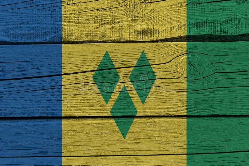 Drapeau de Saint-Vincent-et-les-Grenadines peint sur la vieille planche en bois illustration stock