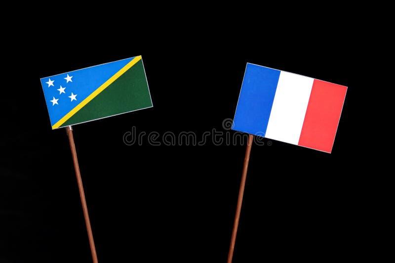 Drapeau de Solomon Islands avec le drapeau français sur le noir images libres de droits
