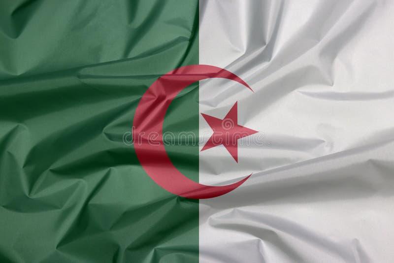 Drapeau de tissu de l'Algérie Pli de fond algérien de drapeau image libre de droits
