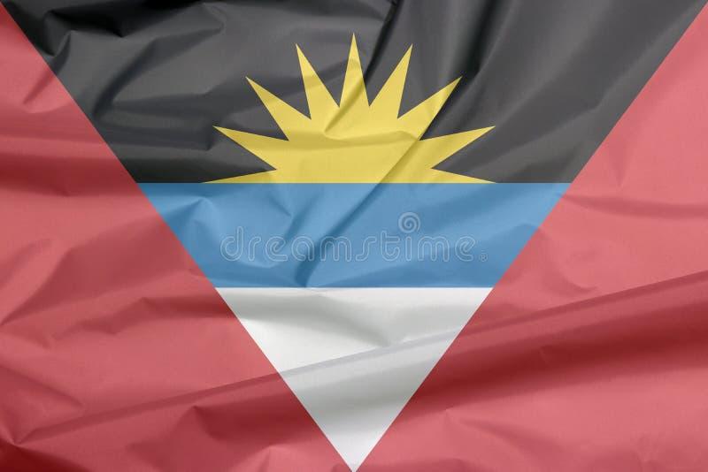 Drapeau de tissu de l'Antigua-et-Barbuda Pli de fond de drapeau de l'Antigua-et-Barbuda illustration stock