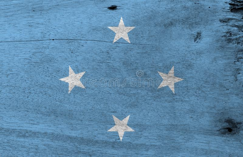 Drapeau des Etats fédérés de Micronésie sur le fond en bois de plat Texture grunge de drapeau des Etats fédérés de Micronésie illustration stock
