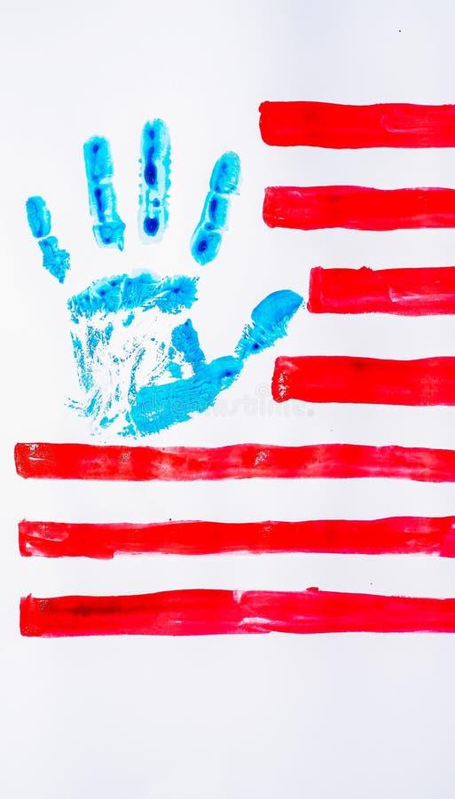 Drapeau des Etats-Unis, main, sur un fond blanc image libre de droits