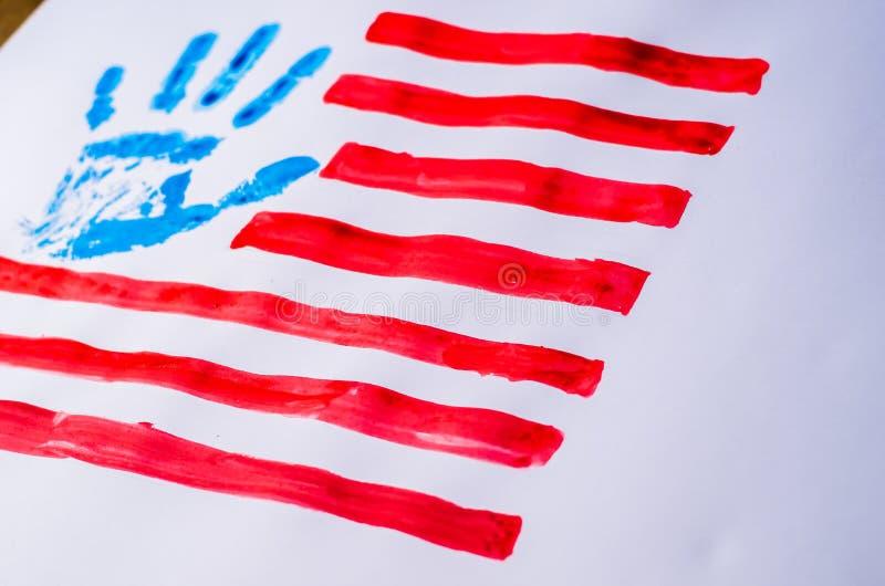 Drapeau des Etats-Unis, main, sur un fond blanc photographie stock