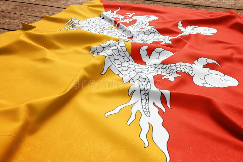 Drapeau du Bhutan sur un fond en bois de bureau Vue sup?rieure de drapeau bhoutanais en soie image libre de droits