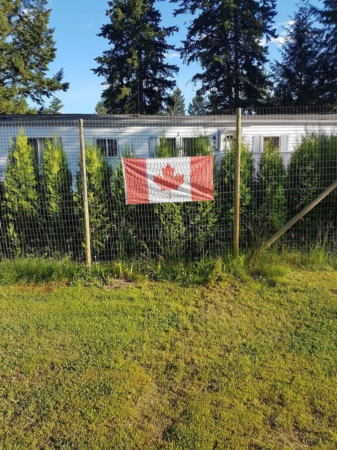 Drapeau du Canada sur la barrière photo libre de droits