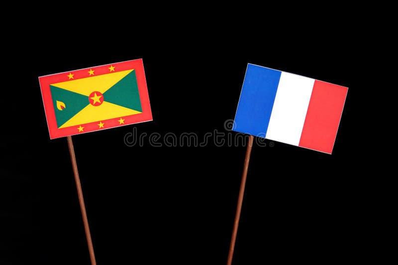 Drapeau du Grenada avec le drapeau français d'isolement sur le noir photo libre de droits
