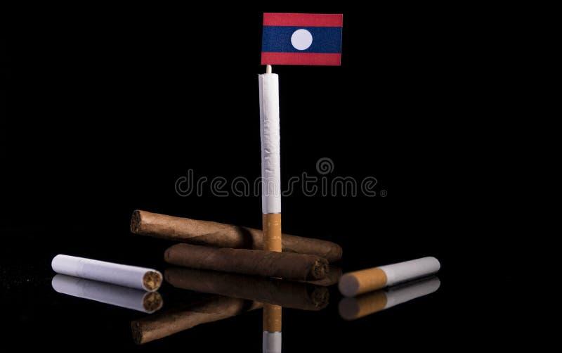 Drapeau du Laos avec des cigarettes et des cigares images libres de droits