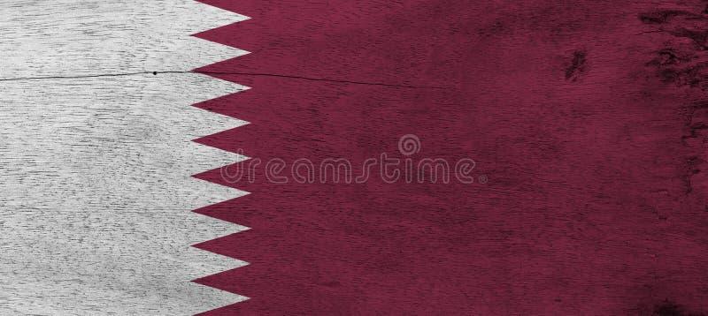 Drapeau du Qatar sur le fond en bois de plat Texture qatarie grunge de drapeau photographie stock libre de droits