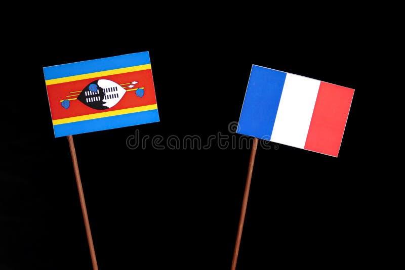 Drapeau du Souaziland avec le drapeau français sur le noir photo libre de droits