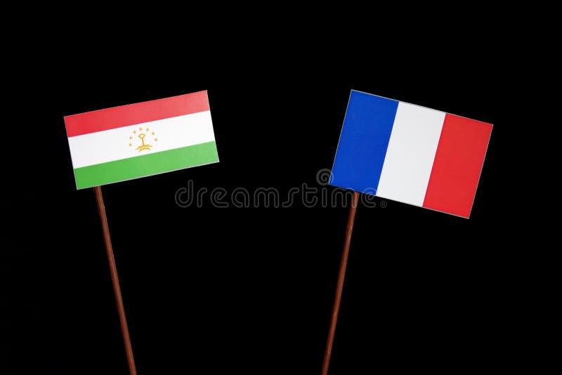 Drapeau du Tadjikistan avec le drapeau français sur le noir image stock