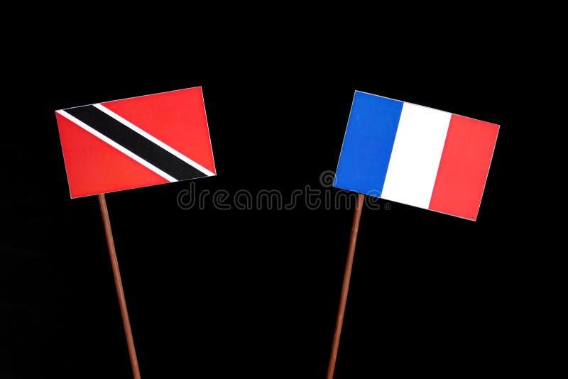Drapeau du Trinidad-et-Tobago avec le drapeau français sur le noir images stock