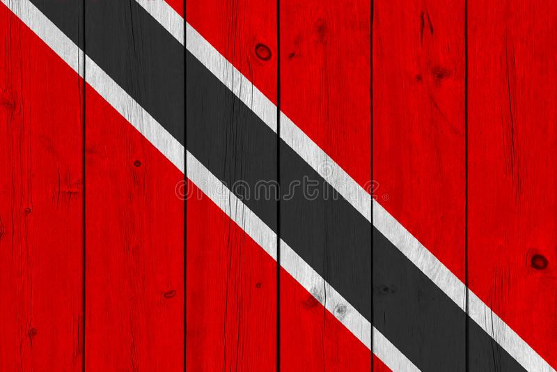 Drapeau du Trinidad-et-Tobago peint sur la vieille planche en bois image stock