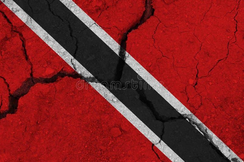 Drapeau du Trinidad-et-Tobago sur la terre criquée image libre de droits