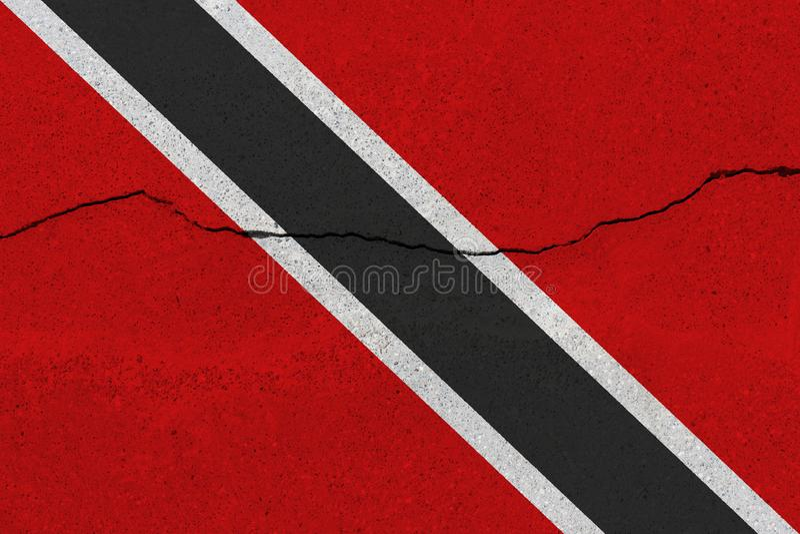 Drapeau du Trinidad-et-Tobago sur le mur en béton avec la fente photographie stock