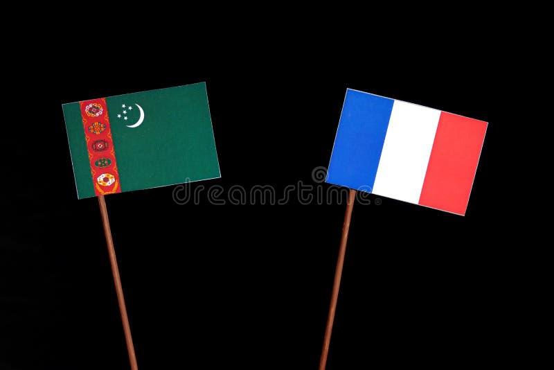 Drapeau du Turkménistan avec le drapeau français sur le noir image stock