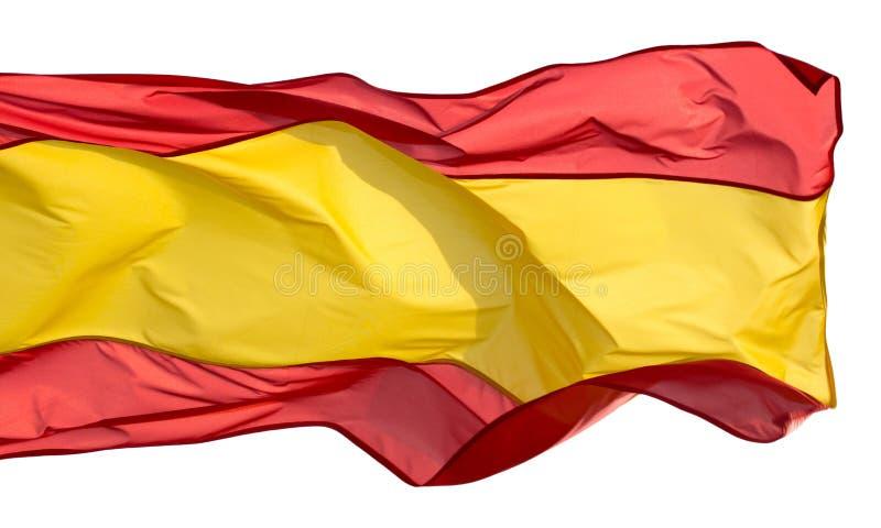 Drapeau espagnol dans le vent sur un fond blanc photos stock