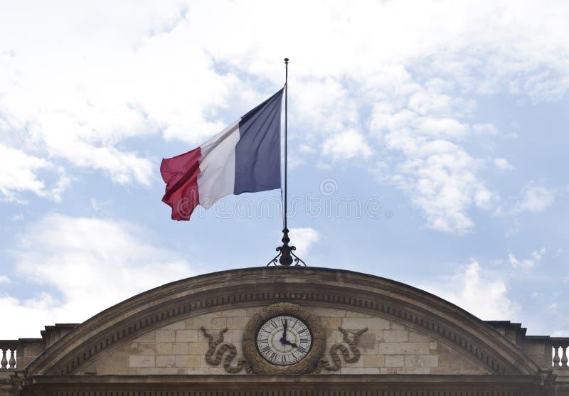 Drapeau français avec l'horloge photos stock