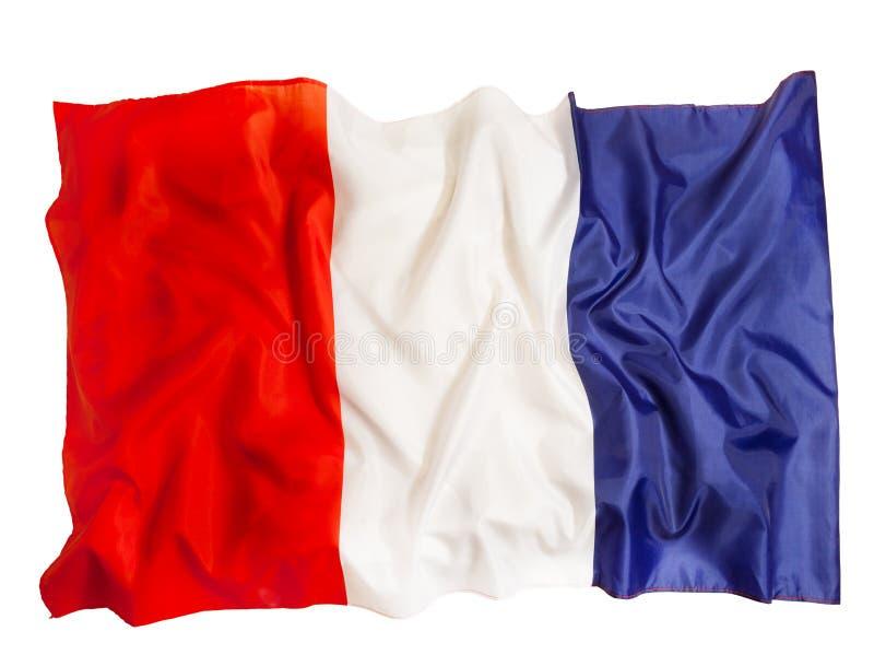 Drapeau français de soie ondulant sur le fond blanc images libres de droits