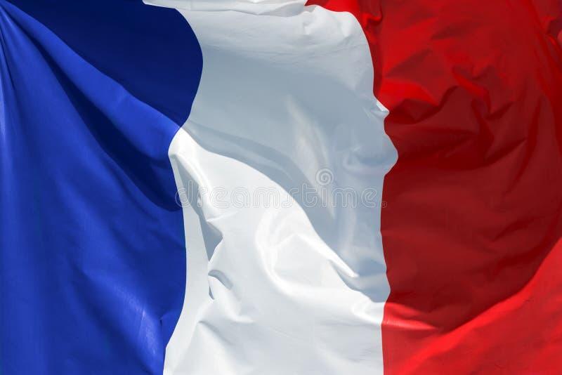 Drapeau français flottant dans le vent photos stock